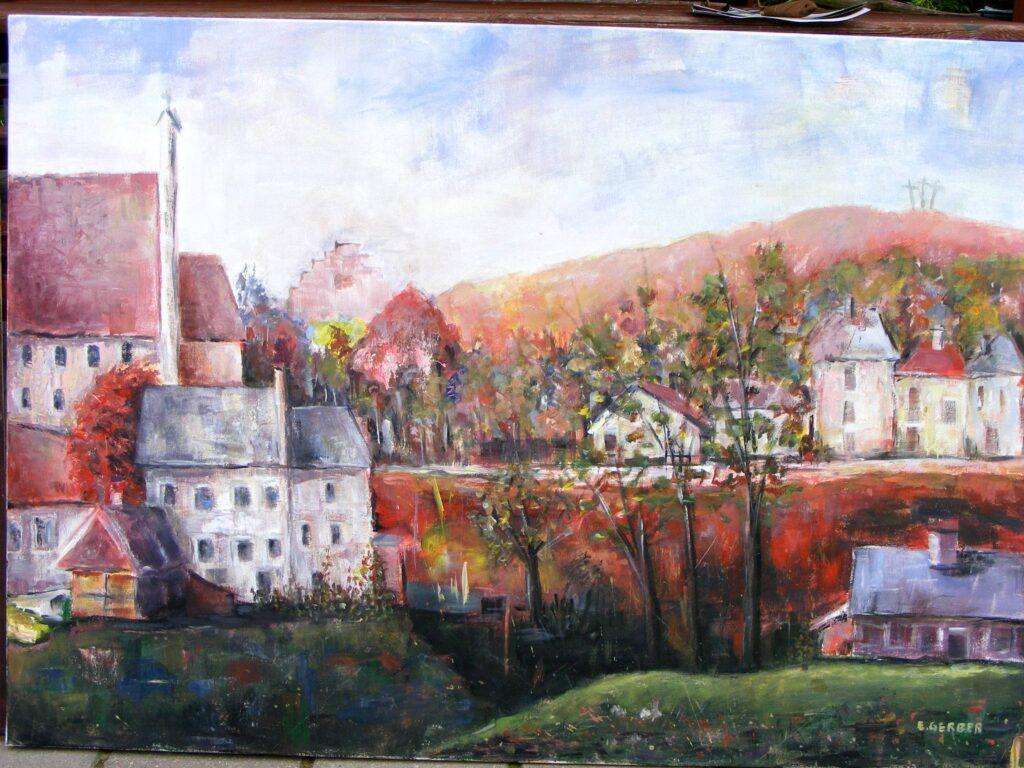 Obraz wykonany na plenerze, przedstawiający budowle małego miasteczka, staw, drogę, a w oddali wzgórze z trzema krzyżami.
